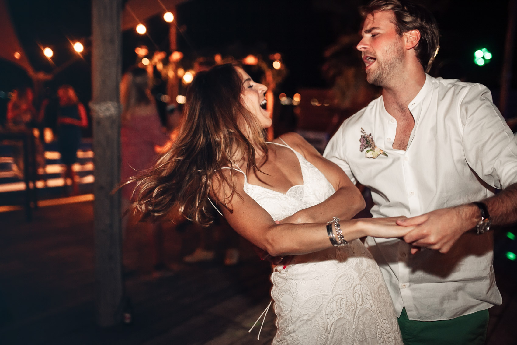 wedding couple dancing restaurant lights beach photography